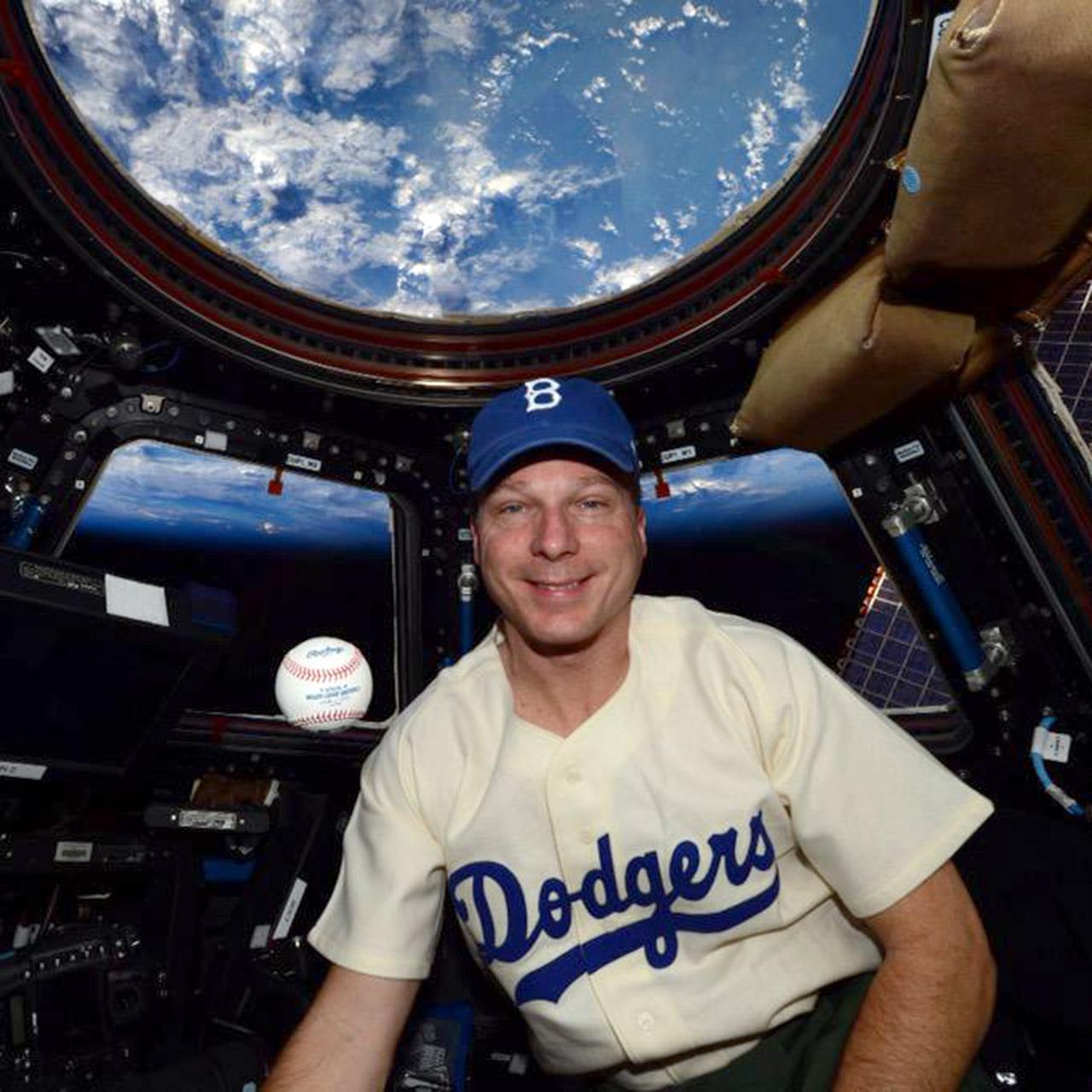 Astronaut Terry Virts wears Jackie Robinson's Brooklyn Dodgers uniform in space