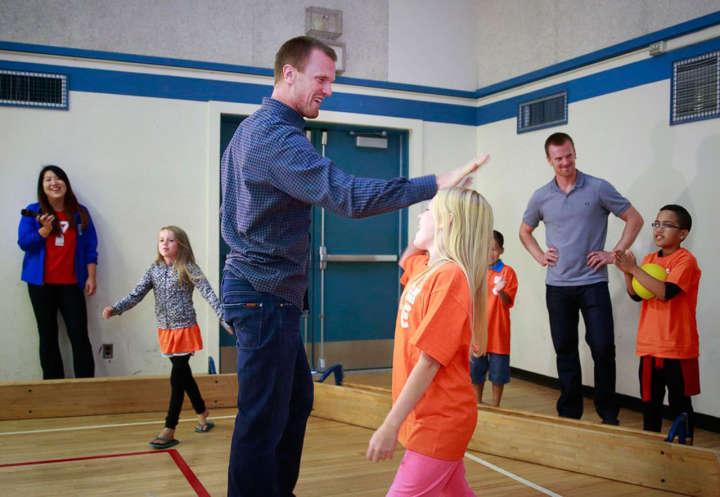 Canucks duo Henrik and Daniel Sedin supporting kids at Sedin Family Foundation