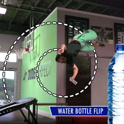 Dude Perfect's Tyler Toney performs water bottle flip trick