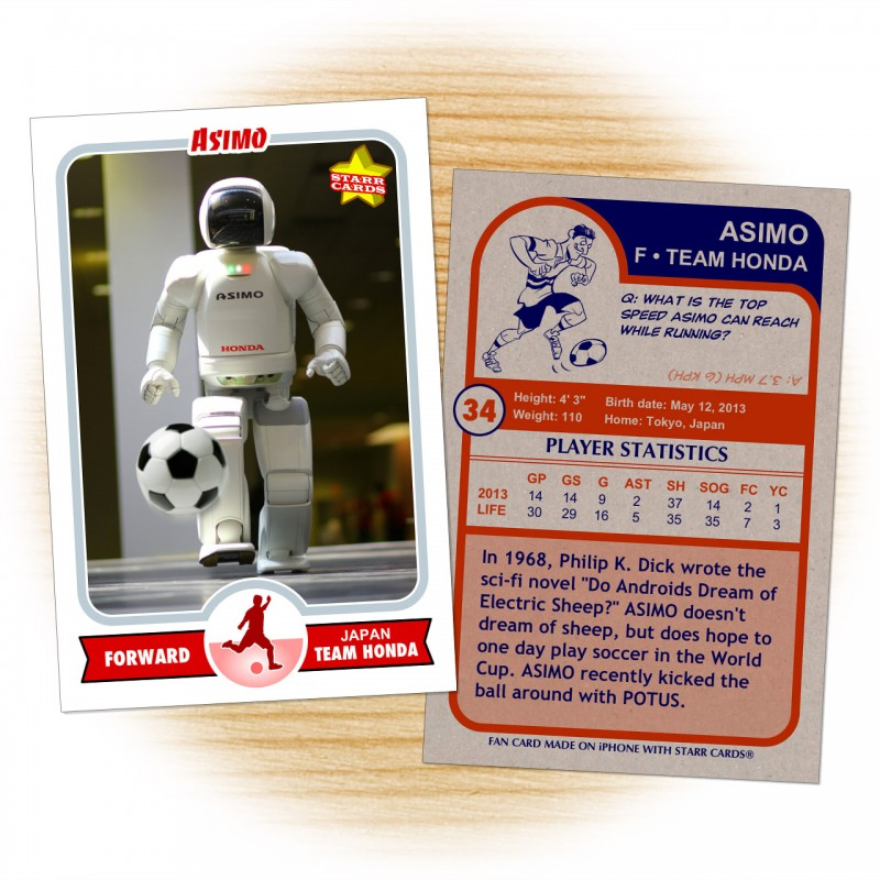 Asimo at a Honda factory kicking a soccer ball