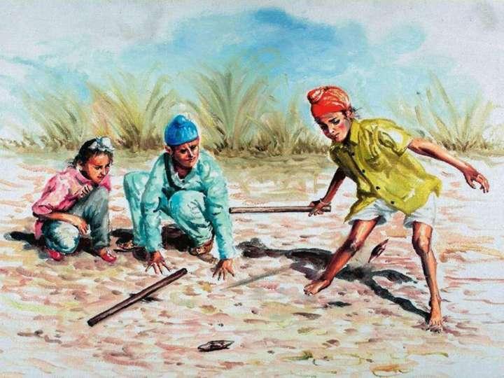 Indian boys playing gilli danda in rural Punjab