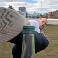 Jason Statham takes the Bottle Cap Challenge