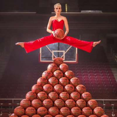 "Katy Perry hovers over a basketball pyramid in promotion for her ""Swish Swish"" music video"