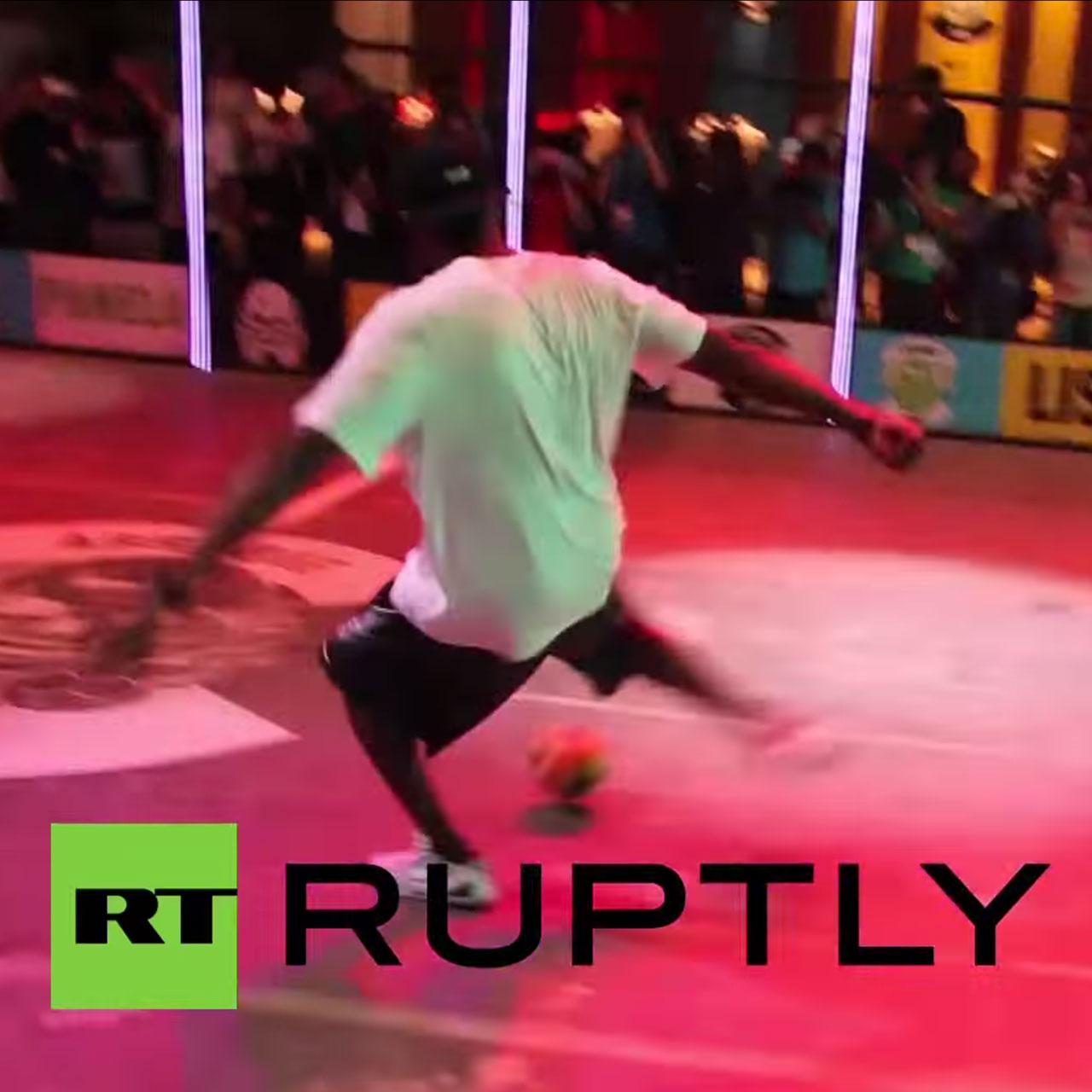 Kobe Bryant plays soccer in Rio.