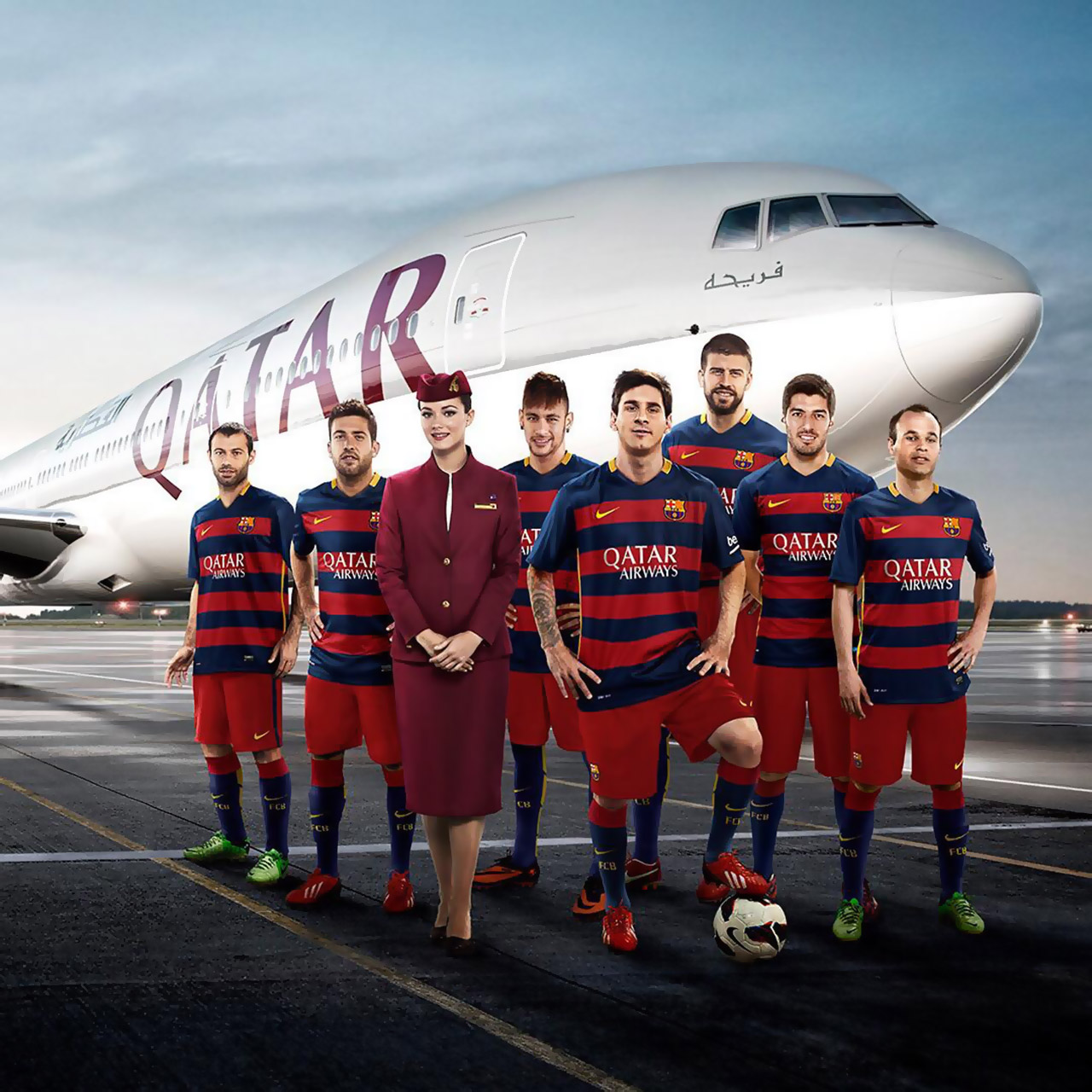 Lionel Messi and FC Barcelona players pose with Qatar Airways jet