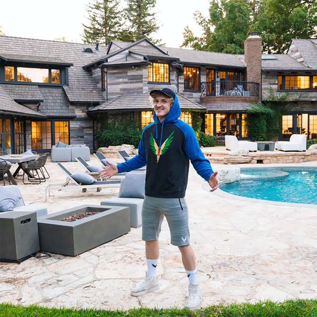 Logan Paul stands in front of his $6.6M mansion in Encino, California