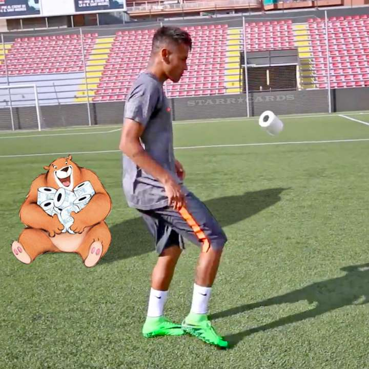 Neymar Jr. juggles a toilet paper roll as Charmin Mama Bear looks on