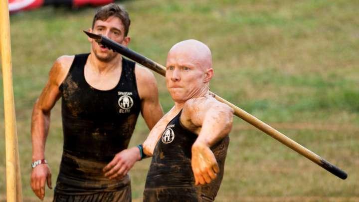 Ninja warrior Kevin Bull tosses a spear on NBC's 'Spartan: Ultimate Team Challenge'