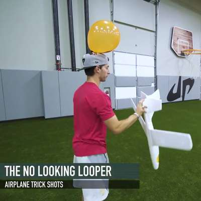 One of Dude Perfect's twins prepares for The No Looking Looper trick shot with styrofoam glider