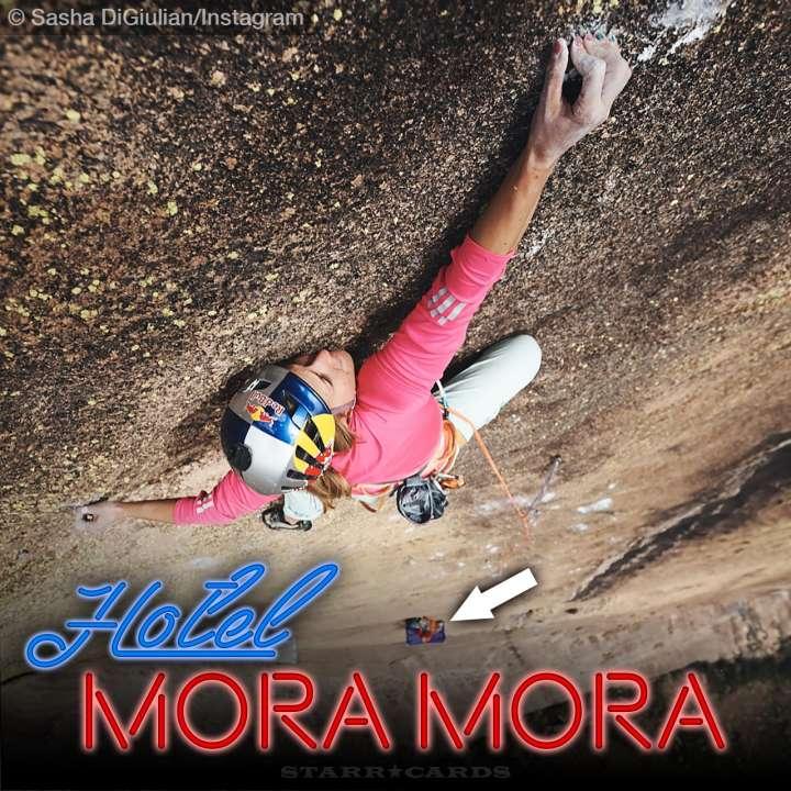 Sasha DiGiulian climbing high above the Hotel Mora Mora in Madagascar