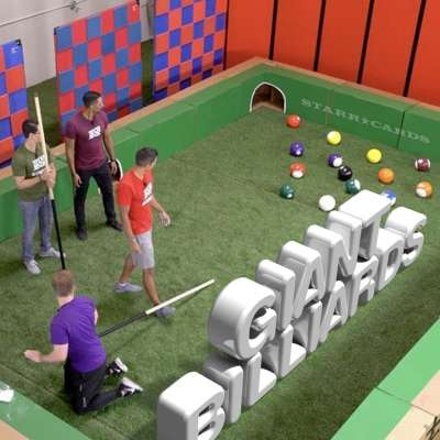 Team Edge plays giant billiards with soccer balls