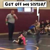 Toddler runs on mat to rescue sister during wrestling match