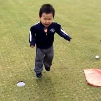 Toddler throws tantrum after missed putt.