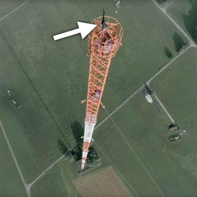 Urban climber does handstand atop 1200-foot tall German radio mast