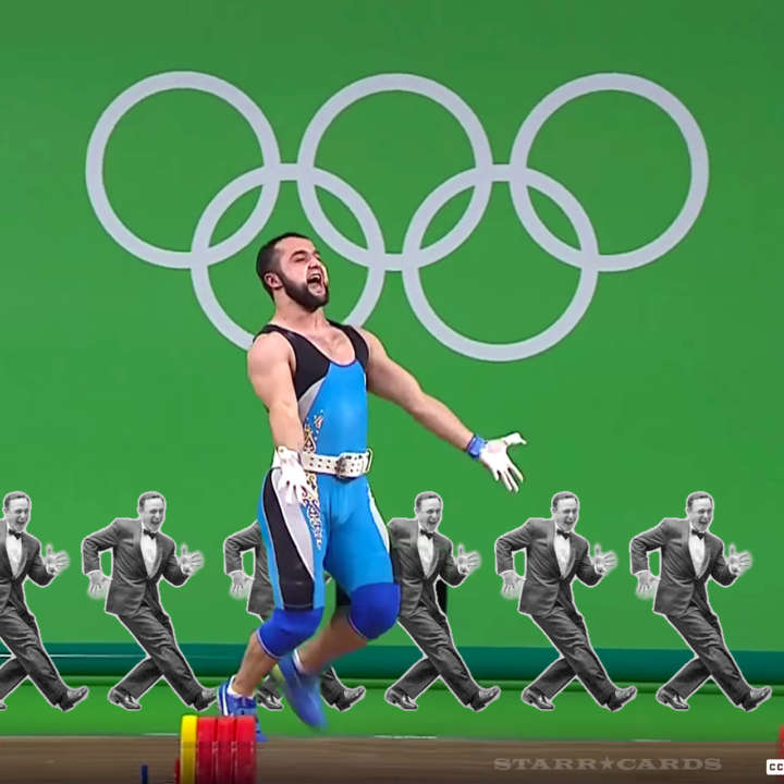 Weightlifter Nijat Rahimov flashes jazz hands after gold medal performance at Rio Olympics