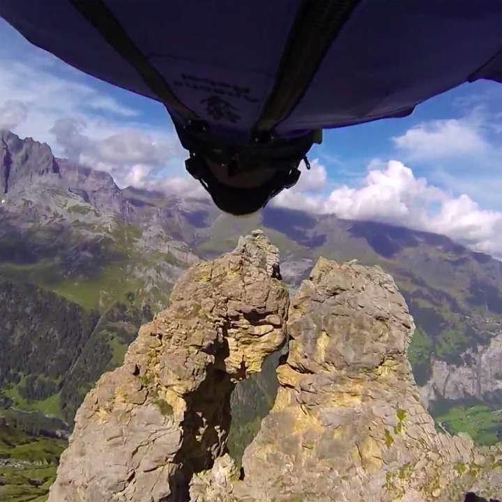 Wingsuit flyer Uli Emanuele flies through 2-meter cave